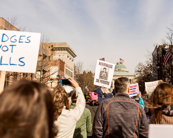 February 11, 2017. Raleigh, North Carolina.<br /> <br /> HKONJ marchers in front of the state capitol held posters depicting civil rights hero Rosa Parks . <br /> <br /> Thousands gathered in downtown Raleigh for the annual HKONJ People's Assembly, a civil rights march tied to the Moral Monday movement. Supporters from around the state gathered to march and speak out against nationwide attacks on civil rights and the Trump administration.<br /> <br /> Jeremy M. Lange for The New York Times