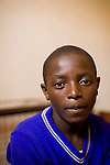 May0016089 . Daily Telegraph..Features.. Emanuel, a 16 year old boy who was beaten and then disowned by his Hutu mother  as a child  after her family killed his Tutsi father and is now one of the orphans residing at the Ngwino Nawe (Come To Us) Children's Village built by Rwanda Aid a British charity and recipient of funds from the Daily Telegraph's 2005 Christmas appeal..Built in Ntendezi in south west Rwanda, the village acts as both home and school for orphans, some victims of the 1994 genocide, and the mentally and physically handicapped...Rwanda 28 August 2009