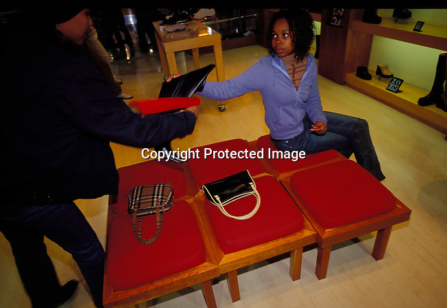 dibusho00087 Business. Shopping. Teenagers buying shoes from a shoe shop in Johannesburg. Fashion, expensive, trendy.©Per-Anders Pettersson/iAfrika Photos