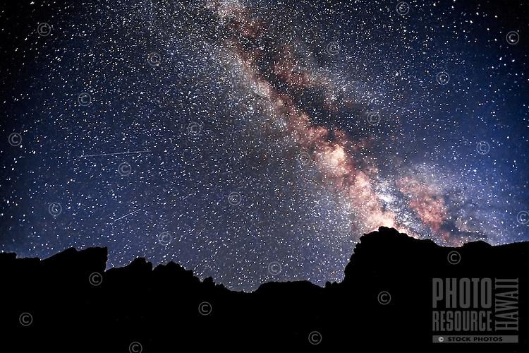 The Milky Way shines above Kalalau Beach at the end of the infamous Kalalau Trail on Kaua'i's Na Pali Coast.