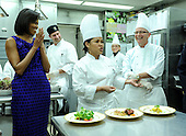 Washington, DC - February 22, 2009 -- White House Head Chef Cristeta Comerford (C), joined by First Lady Michelle Obama (L) and pastry chef Bill Yosses, speaks about the Governors' Dinner menu dinner a preview in the White House kitchen in Washington on Sunday, February 22, 2009. .Credit: Kevin Dietsch - Pool via CNP