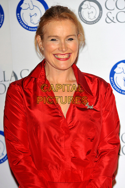 Shauna Lowry.Attending the Battersea Dogs & Cats Home 'Collars & Coats Gala Ball 2012' held at Battersea Evolution, London, England, UK, 8th November 2012. .half length red shirt smiling .CAP/CJ.©Chris Joseph/Capital Pictures.