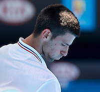 NOVAK DJOKOVIC (SRB) against SANTIAGO GIRALDO (COL) in the second round of the Men's Singles. Novak Djokovic beat Santiago Giraldo 6-3 6-2 6-1..19/01/2012, 19th January 2012, 19.01.2012..The Australian Open, Melbourne Park, Melbourne,Victoria, Australia.@AMN IMAGES, Frey, Advantage Media Network, 30, Cleveland Street, London, W1T 4JD .Tel - +44 208 947 0100..email - mfrey@advantagemedianet.com..www.amnimages.photoshelter.com.