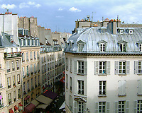 Rooftops of old buildings on the Rue de Buci in the Latin Quarter in Paris, France.