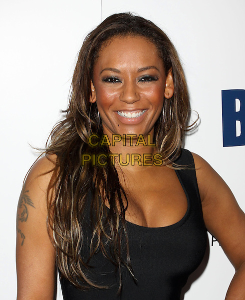 MEL B - MELANIE BROWN - SCARY SPICE.The BritWeek 2010 Champagne Launch held At The British General Consul Residence, Los Angeles, California, USA..April 20th, 2010.headshot portrait black tattoo smiling cleavage .CAP/ADM/KB.©Kevan Brooks/AdMedia/Capital Pictures.