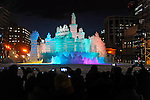 February 5th, 2013 : Sapporo, Japan - A castle made of ice is lit up during the opening night of the Sapporo Yuki Matsuri, or Sapporo Snow Festival in Hokkaido, Japan. The Sapporo Snow Festival marks the 64th year consisting of various shapes and sizes of snow statues and ice sculptures. (Photo by Koichiro Suzuki/AFLO)