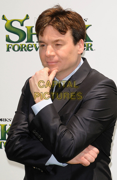 """MIKE MYERS.at DreamWorks Animation's """"Shrek Forever After"""" L.A. Film Premiere held at Gibson Amphitheatre at Universal CityWalk, Universal City, California, USA, May 16th, 2010. .arrivals half length grey gray blue shirt black tie hand arm .CAP/ROT.©Lee Roth/Capital Pictures"""