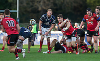 Jack Moates of Jersey plays a pass during the Greene King IPA Championship match between London Scottish Football Club and Jersey at Richmond Athletic Ground, Richmond, United Kingdom on 7 November 2015. Photo by Andy Rowland.