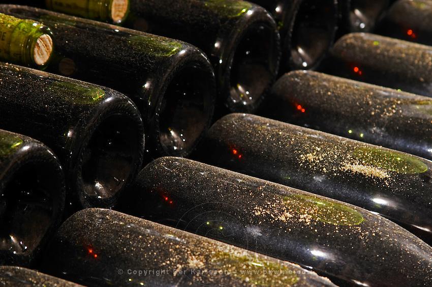 old bottles in the cellar monthelie cote de beaune burgundy france