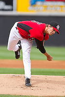 Starting pitcher Justin Grimm #25 of the Hickory Crawdads follows through on his delivery against the Greensboro Grasshoppers at L.P. Frans Stadium on May 18, 2011 in Hickory, North Carolina.   Photo by Brian Westerholt / Four Seam Images