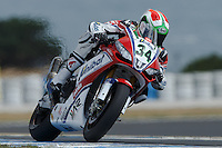 Davide Giugliano (ITA) riding the Aprilia RSV4 1000 Factory (34) of the Althea Racing team exits turn 6 during a qualifying session on day one of round one of the 2013 FIM World Superbike Championship at Phillip Island, Australia.