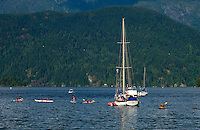 Paddling in canoes. Deep Cove, Burrard Inlet, Vancouver, British Columbia, Canada.