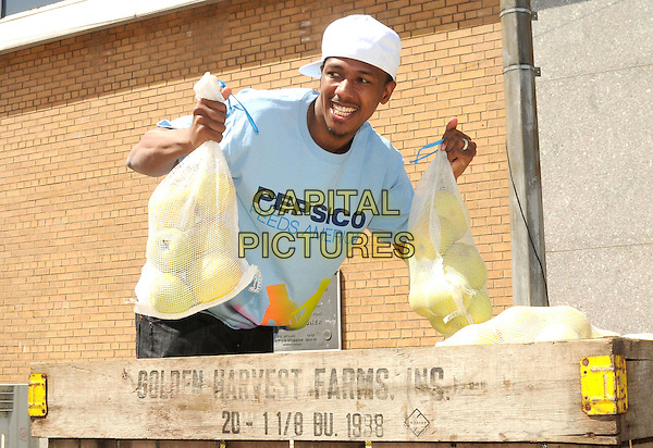 NICK CANNON.PepsiCo & Feeding America Day Of Service At City Harvest, New York, NY, USA..April 20th, 2010.half length bag bags  fruit food apple apples blue t-shirt white baseball cap hat goatee facial hair .CAP/ADM/BM.©Bill Menzel/AdMedia/Capital Pictures.