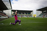 One of the visiting substitutes going through a stretching routine at Easter Road stadium during the first-half of the Scottish Championship match between Hibernian and visitors Alloa Athletic. The home team won the game by 3-0, watched by a crowd of 7,774. It was the Edinburgh club's second season in the second tier of Scottish football following their relegation from the Premiership in 2013-14.