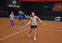 April 15, 2015, Netherlands, Den Bosch, Maaspoort, Fedcup Netherlands-Australia, Clinic with Alex Reijnders and schoolkids <br /> Photo: Tennisimages/Henk Koster