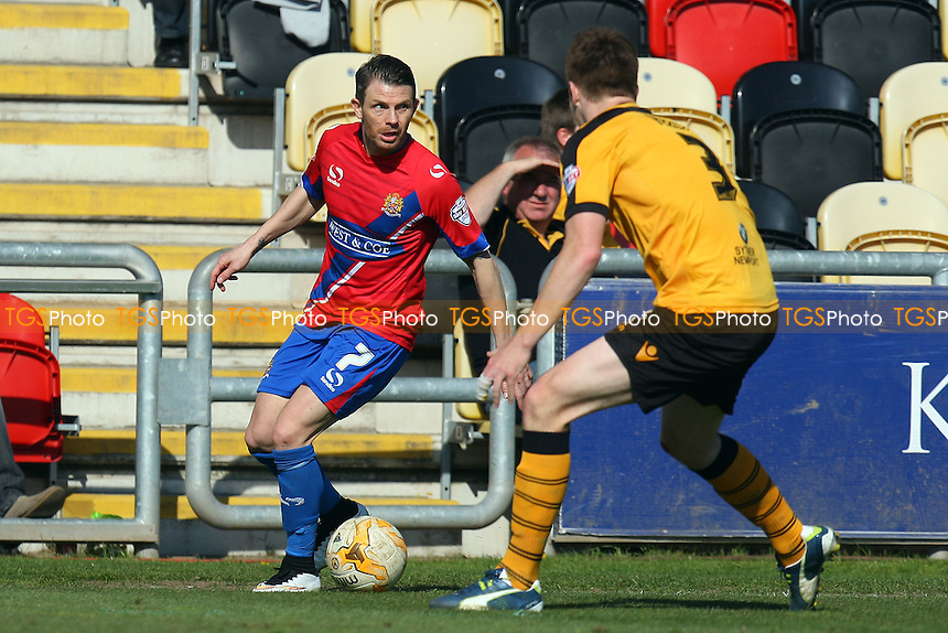 Jamie Cureton of Dagenham and Redbridge and Kevin Feely of Newport County - Newport County AFC Dagenham and Redbridge - Sky Bet League Two action at the Rodney Parade Stadium on 18/04/15 - MANDATORY CREDIT: Dave Simpson/TGSPHOTO - Self billing applies where appropriate - 0845 094 6026 - contact@tgsphoto.co.uk - NO UNPAID USE