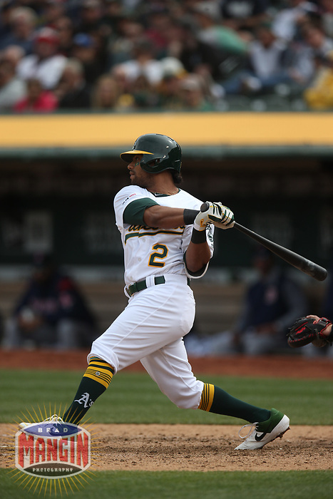 OAKLAND, CA - APRIL 4:  Khris Davis #2 of the Oakland Athletics bats against the Boston Red Sox during the game at the Oakland Coliseum on Thursday, April 4, 2019 in Oakland, California. (Photo by Brad Mangin)