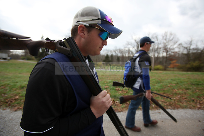 UK Trap and Skeet president Daniel Birkenhauer and Vice President of sporting clays, Cyrus Alexander grab their guns on Thursday, Nov. 19, 2009 at the Bluegrass Sportsman League in Wilmore, Ky