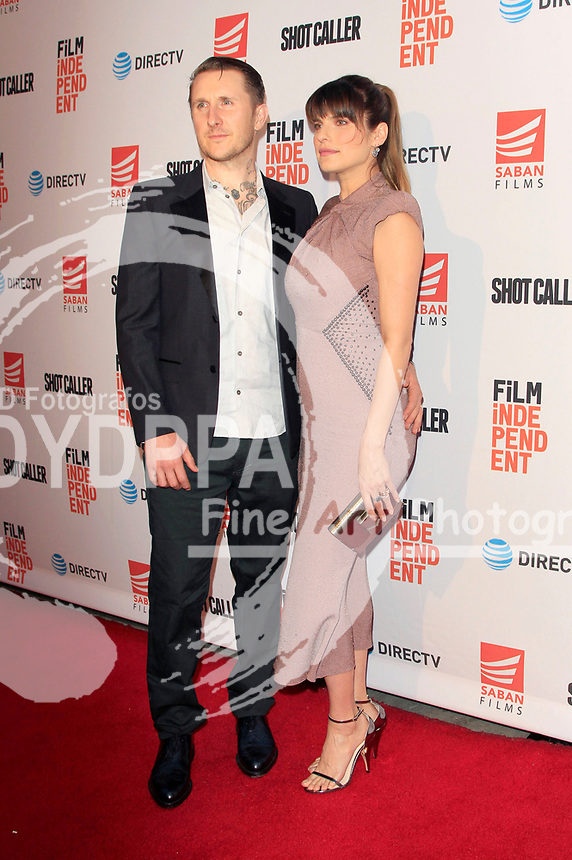 Lake Bell and her husband Scott Campbell attend the premiere of 'Shot Caller' at The Theatre at Ace Hotel on August 15, 2017 in Los Angeles, California.
