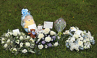 Pictured: Flowers left after the burial at Thornhill Cemetery, Cardiff, Wales, UK. Tuesday 28 June 2016<br /> Re: The funeral of Sion, the baby boy found dead in the River Taff in Cardiff has taken place<br /> Generous locals raised nearly &pound;1,400 for the memorial after reading about plans to hold a fitting ceremony for the newborn baby whose body was discovered in Cardiff a year ago.<br /> The funeral took place at the Briwnant Chapel at Thornhill Crematorium, Cardiff. Members of the public are invited to be among the congregation.