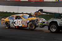 Apr 22, 2006; Phoenix, AZ, USA; Nascar Nextel Cup driver Elliott Sadler of the (38) Pedigree/M&ms Ford Fusion is towed off the track after a crash during the Subway Fresh 500 at Phoenix International Raceway. Mandatory Credit: Mark J. Rebilas-US PRESSWIRE Copyright © 2006 Mark J. Rebilas..