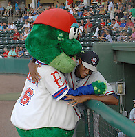Pitcher Ronan Pacheco (32) of the Rome Braves jokes with the Greenville Drive's mascot, Reedy Rip'It, near the visitors' dugout prior to a game between the teams on July 18, 2011, at Fluor Field at the West End in Greenville, South Carolina. (Tom Priddy/Four Seam Images)