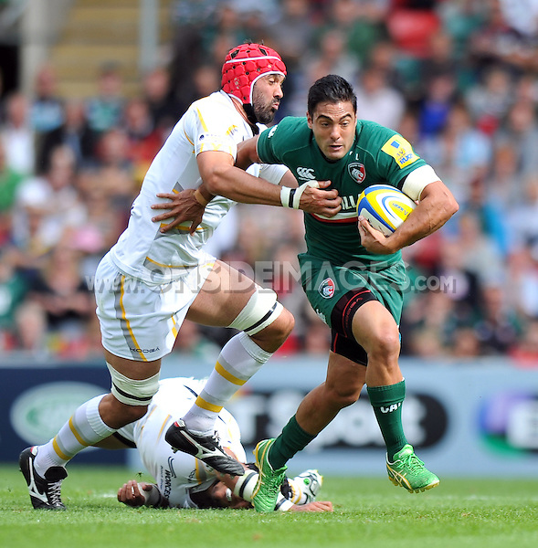 Dan Bowden looks to get past Jonathan Thomas. Aviva Premiership match, between Leicester Tigers and Worcester Warriors on September 8, 2013 at Welford Road in Leicester, England. Photo by: Patrick Khachfe / JMP
