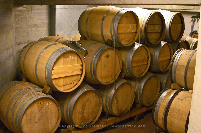 Wooden barrels in the wine cellar. Alain Voge, Cornas, Ardeche, Ardèche, France, Europe