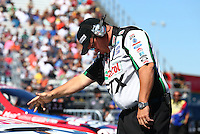 Sept. 22, 2013; Ennis, TX, USA: Crew chief Jimmy Prock guides NHRA funny car driver John Force into the staging beams during the Fall Nationals at the Texas Motorplex. Mandatory Credit: Mark J. Rebilas-