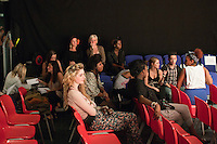 Discussions immediately after the final rehearsal for a Fashion Show at Further Education College.