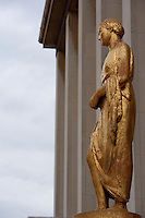 "PARIS, FRANCE -  APRIL 27 : A low angle view of ""La Campagne"" on 27 April 2008, at the Palais de Chaillot in the 16th arrondissement of Paris, France. The gilded bronze sculpture of a standing woman, an allegory of the countryside, adorns the facade of the Art Deco Palais de Chaillot, built in 1937 for the International Exhibition since the inauguration of the building. It was created by Paul Cornet, 1892-1977, a figurative sculptor who worked from nature producing many sensitive portraits of women. La Campagne is seen here on a late spring afternoon. (Photo by Manuel Cohen)"