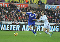 SWANSEA, WALES - JANUARY 17:   of  during the Barclays Premier League match between Swansea City and Chelsea at Liberty Stadium on January 17, 2015 in Swansea, Wales.<br /> <br /> Chelsea's Diego Costa being chased down by Swansea's Tom Carroll