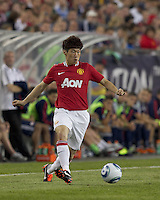 Manchester United FC midfielder Ji-Sung Park (13) passes the ball. In a Herbalife World Football Challenge 2011 friendly match, Manchester United FC defeated the New England Revolution, 4-1, at Gillette Stadium on July 13, 2011.