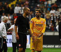 Bas Dost (Eintracht Frankfurt) mit Torwart Kevin Trapp (Eintracht Frankfurt) - 01.09.2019: Eintracht Frankfurt vs. Fortuna Düsseldorf, Commerzbank Arena, 3. Spieltag<br /> DISCLAIMER: DFL regulations prohibit any use of photographs as image sequences and/or quasi-video.
