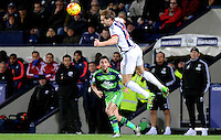 Craig Dawson of West Bromwich Albion watched by Neil Taylor of Swansea City during the Barclays Premier League match between West Bromwich Albion and Swansea City at The Hawthorns on the 2nd of February 2016
