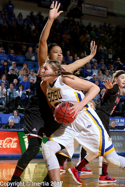 BROOKINGS, SD - MARCH 16:  Clarissa Ober #21 from South Dakota State University looks to make a move past Cassidy Glenn #1 from Northern Illinois during their first round WNIT game Thursday at Frost Arena in Brookings.(Photo by Dave Eggen/Inertia)