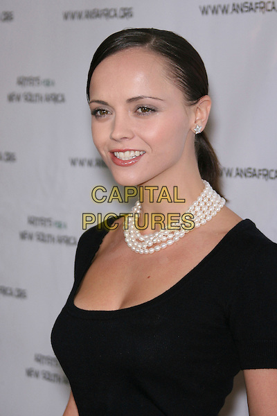 CHRISTINA RICCI.Archbishop Desmond Tutu Honored by Artists for a New South Africa for his 75th Birthday Celebration - Arrivals held at the Regent Beverly Wilshire Hotel, Beverly Hills, California, USA..September 18th, 2006.Ref: ADM/ZL.headshot portrait pearl necklace black.www.capitalpictures.com.sales@capitalpictures.com.©Zach Lipp/AdMedia/Capital Pictures.