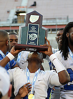 Armwood Hawks quarterback Darryl Richardson #6 kisses the trophy after the Florida High School Athletic Association 6A Championship Game at Florida's Citrus Bowl on December 17, 2011 in Orlando, Florida.  Armwood defeated Miami Central 40-31.  (Mike Janes/Four Seam Images)
