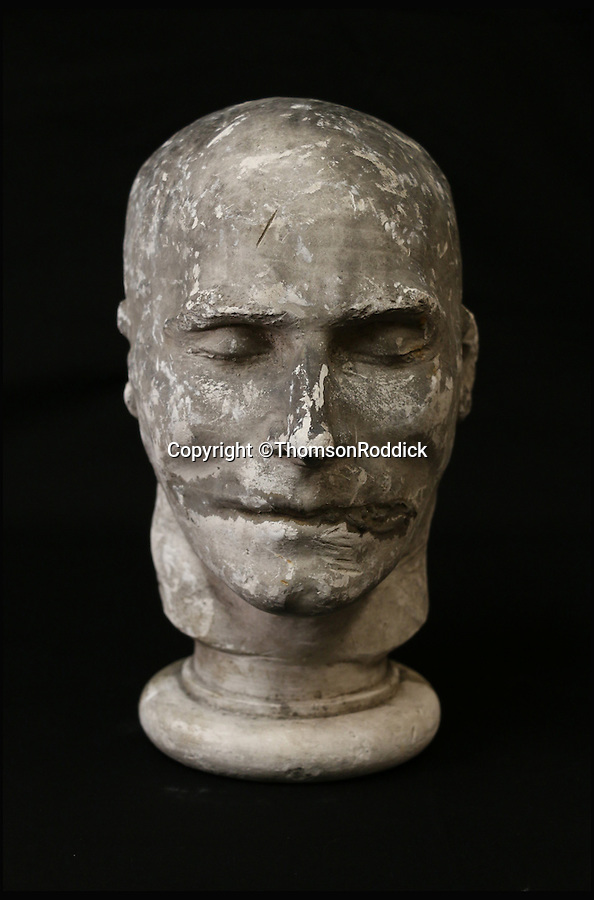 BNPS.co.uk (01202 558833)<br /> Pic: ThomsonRoddick/BNPS<br /> <br /> 19th century plaster death mask head of a man, by J. DeVille sold for £1,300.<br /> <br /> These disturbing Victorian plaster cast heads of notorious criminals are a far cry from today's bland mugshots of lowlifes.<br /> <br /> Two of the heads have been identified as Benjamin Courvoisier, a serial killer in the mould of Jack the Ripper, and coachman Daniel Good who mutilated his pregnant mistress. <br /> <br /> In total, nine heads were discovered at an outbuilding at a rural home just outside Penrith, Cumbria, which have now fetched almost £40,000 at auction. <br /> <br /> Experts predicted the collection of heads would sell for £2,000  but Courvoisier's head alone went for £20,000.<br /> <br /> Two of the heads were made by the famous British exponent of phrenology, James De Ville, who built a private museum of more than 5,000 specimens.