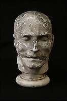 BNPS.co.uk (01202 558833)<br /> Pic: ThomsonRoddick/BNPS<br /> <br /> 19th century plaster death mask head of a man, by J. DeVille sold for &pound;1,300.<br /> <br /> These disturbing Victorian plaster cast heads of notorious criminals are a far cry from today's bland mugshots of lowlifes.<br /> <br /> Two of the heads have been identified as Benjamin Courvoisier, a serial killer in the mould of Jack the Ripper, and coachman Daniel Good who mutilated his pregnant mistress. <br /> <br /> In total, nine heads were discovered at an outbuilding at a rural home just outside Penrith, Cumbria, which have now fetched almost &pound;40,000 at auction. <br /> <br /> Experts predicted the collection of heads would sell for &pound;2,000  but Courvoisier's head alone went for &pound;20,000.<br /> <br /> Two of the heads were made by the famous British exponent of phrenology, James De Ville, who built a private museum of more than 5,000 specimens.