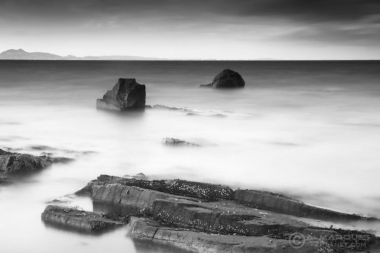 Incoming tide at the Longniddry Bents, East Lothian, Scotland. .The hill on background is Arthur's Seat, the iconinc volcano right in the middle of Edinburgh. .Hitech Pro Stopper 10 + GND 0.9