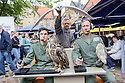 """Cast members, Lewis Howard (as Callum), Alan Munden, and  Ben Dyson (as Paddy) from """"Swivelhead"""", Pipeline Theatre's new play, meet a barn owl and an eagle owl in the courtyard at the Pleasance. """"Swivelhead"""" runs from 3rd - 29th August in Pleasance 2."""