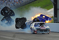 Jun. 18, 2011; Bristol, TN, USA: NHRA pro mod driver Roger Burgess loses control and crashes after winning his first round race against Kenny Lang during eliminations at the Thunder Valley Nationals at Bristol Dragway. Mandatory Credit: Mark J. Rebilas-