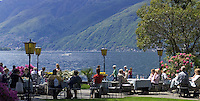 CHE, Schweiz, Tessin, Ascona am Lago Maggiore: Café Castello an der Promenade mit Park und direkt am See | CHE, Switzerland, Ticino, Ascona at Lago Maggiore: cafes and restaurants at the promenade