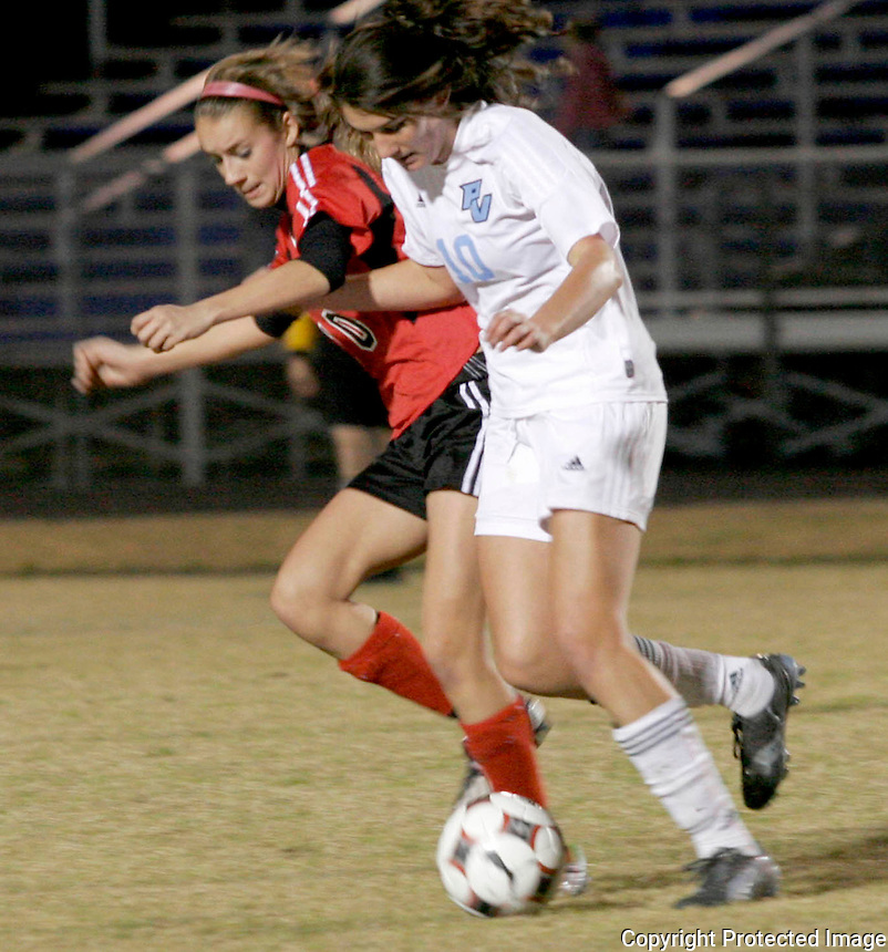 Gary Wilcox/specialÉ01/23/09..  Ponte Vedra High Soccer player Jackie Hellett (#10) and Creekside's Lexi Bochino (#10) (left) go after the balduring the  Ponte Vedra High vs  Creekside High School Girls district 5-4A championship game at Menendez High Friday night.(01/23/