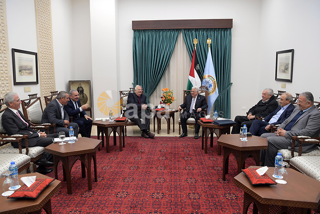 Palestinian President Mahmoud Abbas meets with Chairman of the Palestinian Central Election Committee Hanna Nasser, in the West Bank city of Ramallah, on December 8, 2019. Photo by Thaer Ganaim