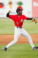 Tim Anderson (2) of the Kannapolis Intimidators makes a throw to first base against the Greenville Drive at CMC-Northeast Stadium on June 29, 2013 in Kannapolis, North Carolina.  The Intimidators defeated the Drive 9-3 in the completion of the game that began on June 28, 2013.   (Brian Westerholt/Four Seam Images)