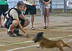 Chris Gavin and his daughter Jordyn wait at the finish line for their dog Moose who placed second at the annual Wiener Dog Races at the Reno Rodeo in Reno, Nev., on Saturday, June 28, 2014.<br /> Photo by Cathleen Allison