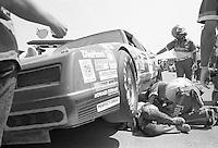 Joe Ruttmann crew works on car service car 30th place finish Winston 500 at Alabama International Motor Speedway in Talladega , AL on May 5, 1985. (Photo by Brian Cleary/www.bcpix.com)