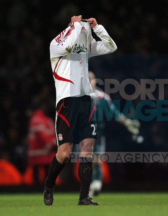Liverpool's Jamie Carragher looks on dejected